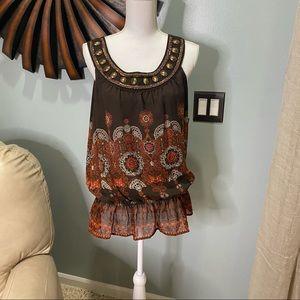 Sleeveless tunic with beautiful embellishments